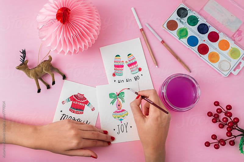 Woman Painting Christmas Cards by Katarina Radovic for Stocksy United