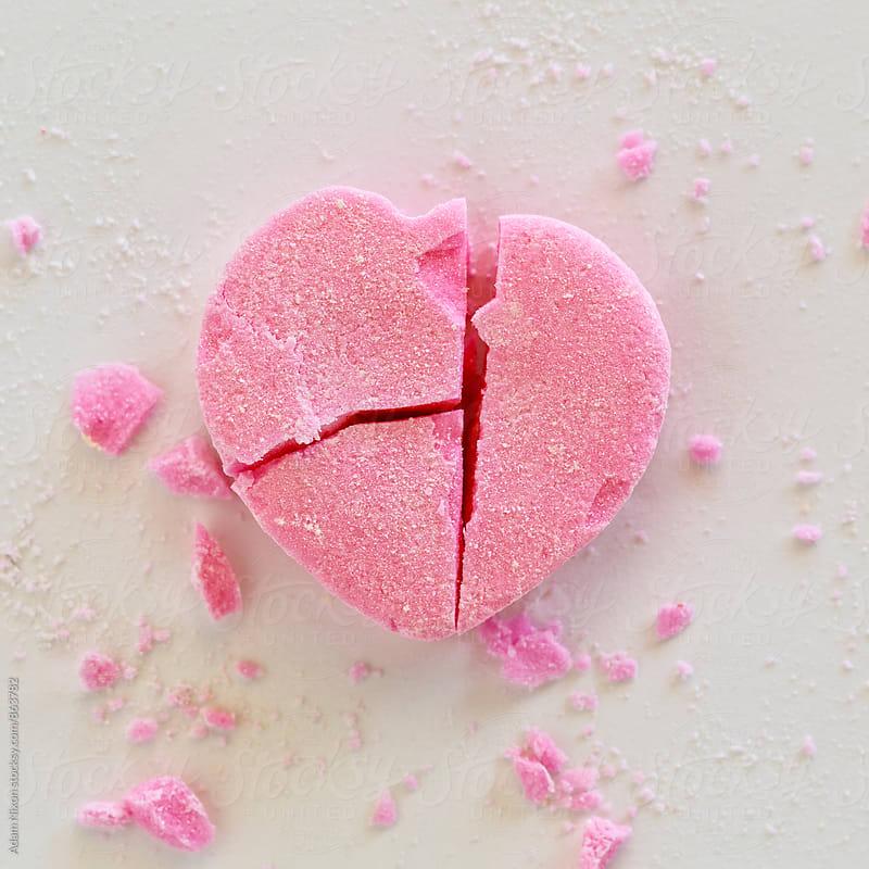 Broken pink heart candy by Adam Nixon for Stocksy United