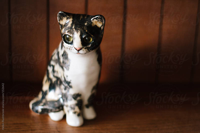 A ceramic cat by Helen Rushbrook for Stocksy United