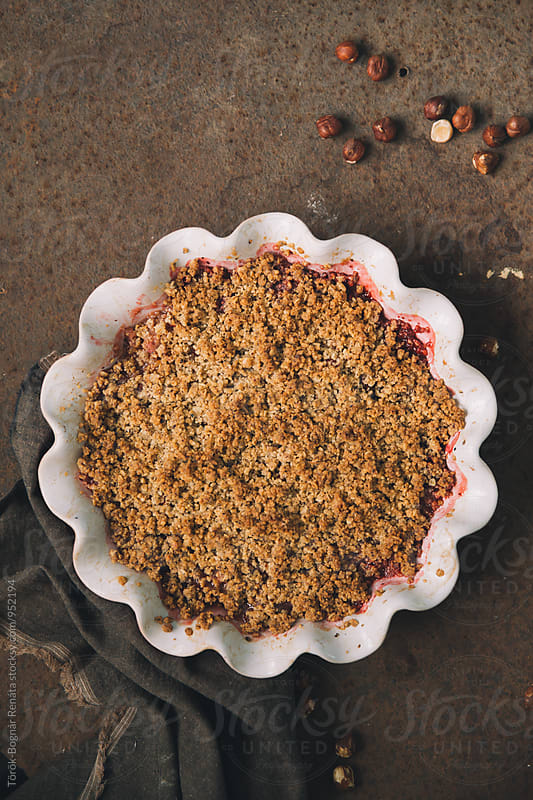 Rhubarb and strawberry crumble by Török-Bognár Renáta for Stocksy United