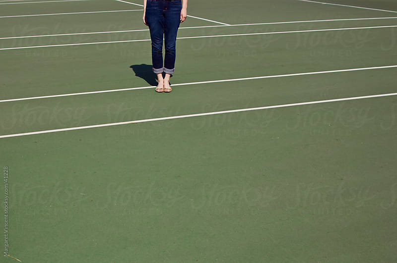 feet on tennis court by Margaret Vincent for Stocksy United