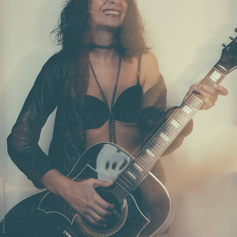 Woman playing guitar by Mauro Grigollo for Stocksy United