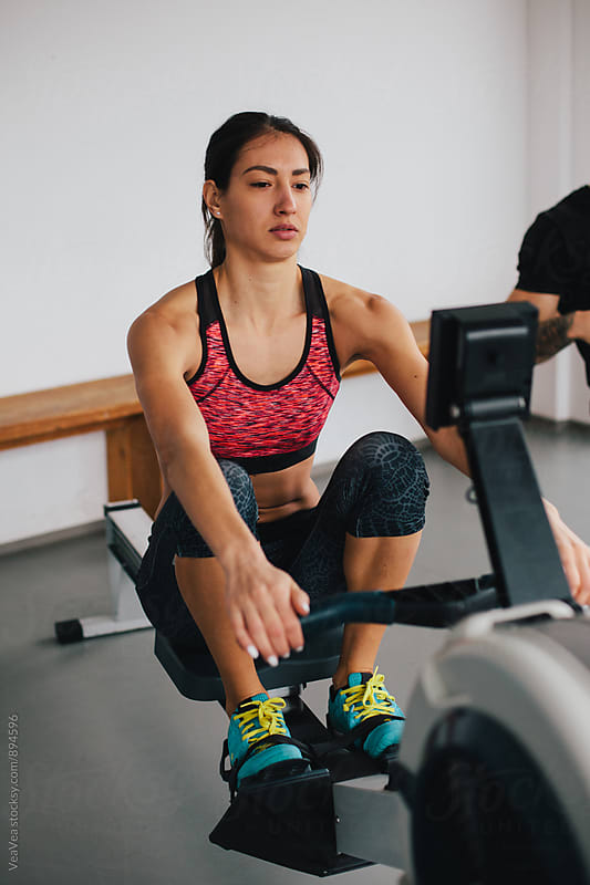Woman training on ergometer by VeaVea for Stocksy United