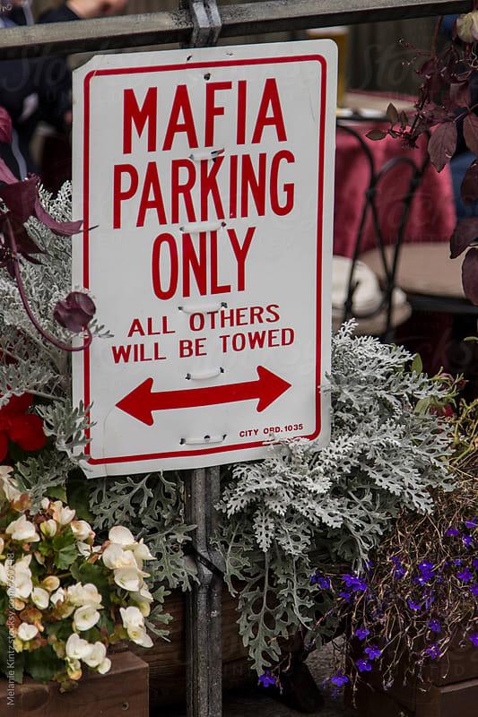 Sign: Mafia parking only by Melanie Kintz for Stocksy United