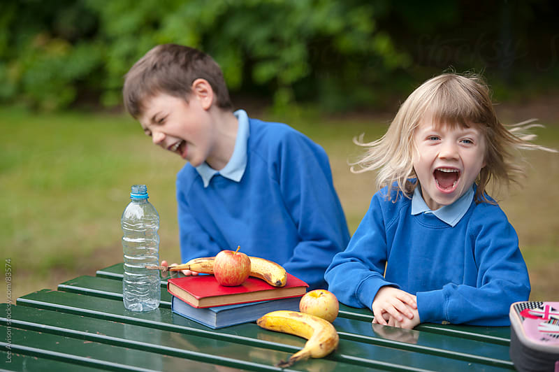 two children in school uniform by Lee Avison for Stocksy United