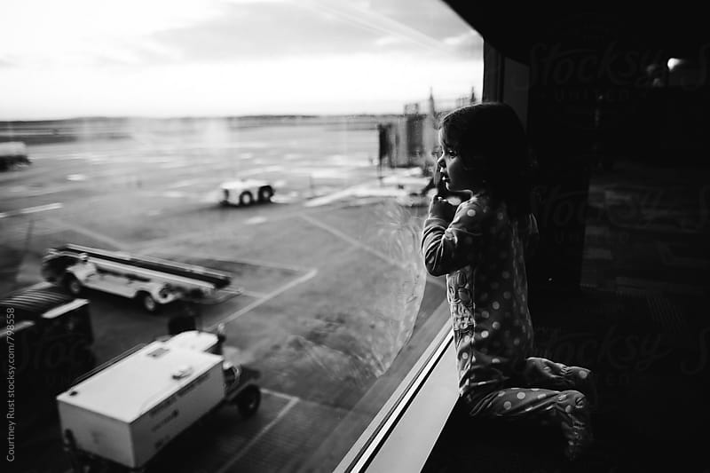 Waiting for the plane in airport by Courtney Rust for Stocksy United