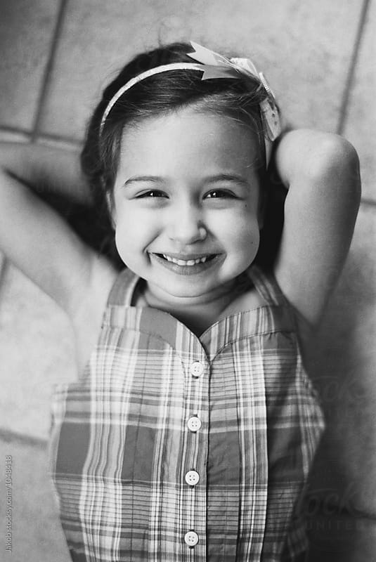 Black and white portrait of a beautiful young girl smiling by Jakob for Stocksy United