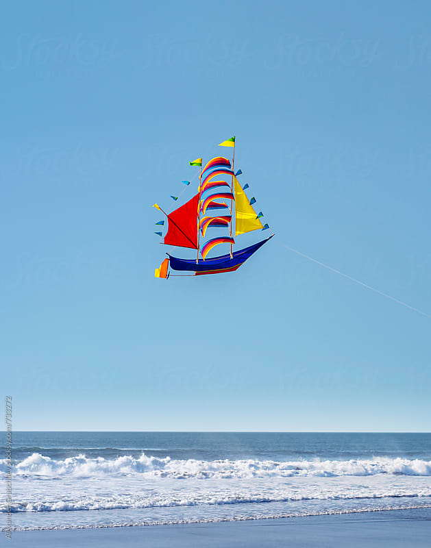 The flying ship on the blue sky background by Alexander Grabchilev for Stocksy United