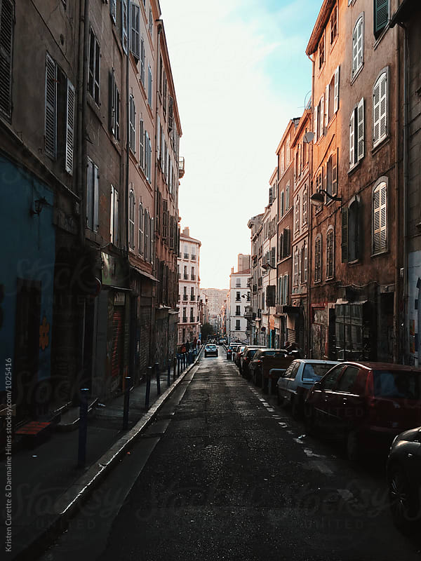 Mobile phone capture down an empty inner city alleyway by Kristen Curette Hines for Stocksy United
