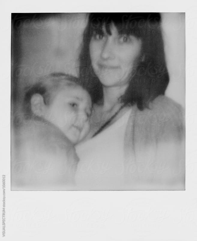 Black and White Instant Photograph of Mother With Small Boy by Julien L. Balmer for Stocksy United