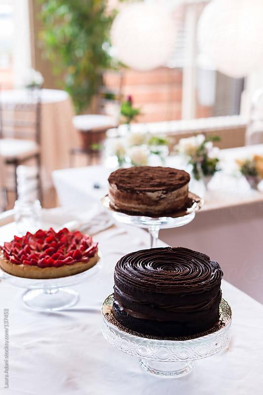 chocolate cake, strawberries tart and tiramisù dessert by Laura Adani for Stocksy United