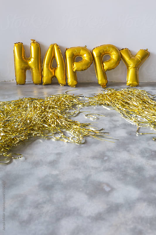 Gold balloons that spell the word 'HAPPY' with copyspace, vertical by Jacqui Miller for Stocksy United