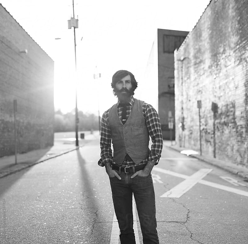 Portrait of a bearded and stylish man in an urban setting by Jakob for Stocksy United