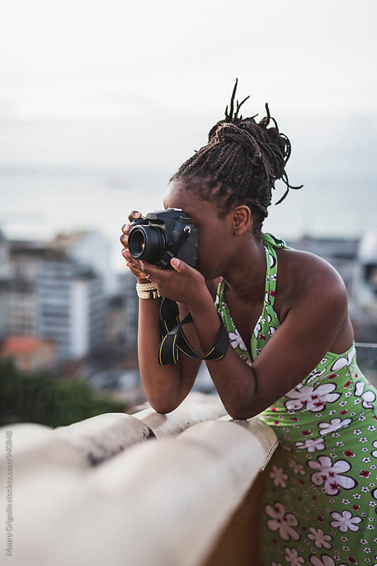 Brazil. Woman taking pictures by Mauro Grigollo for Stocksy United