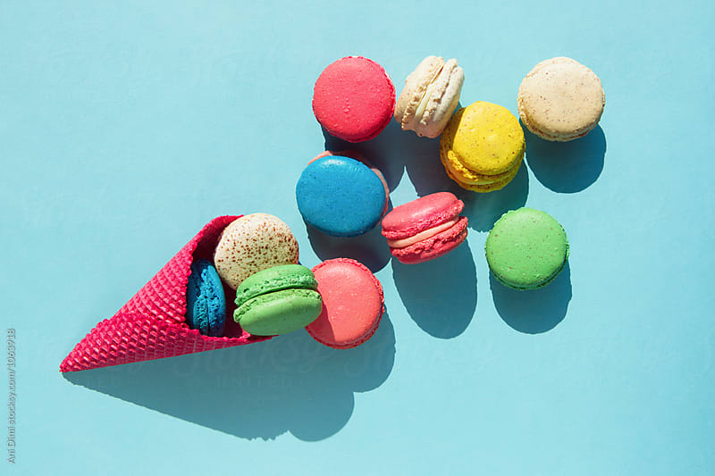Ice cream cone and macaroons by Ani Dimi for Stocksy United