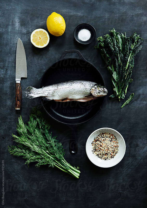 Dinner fish prep by Ellie Baygulov for Stocksy United