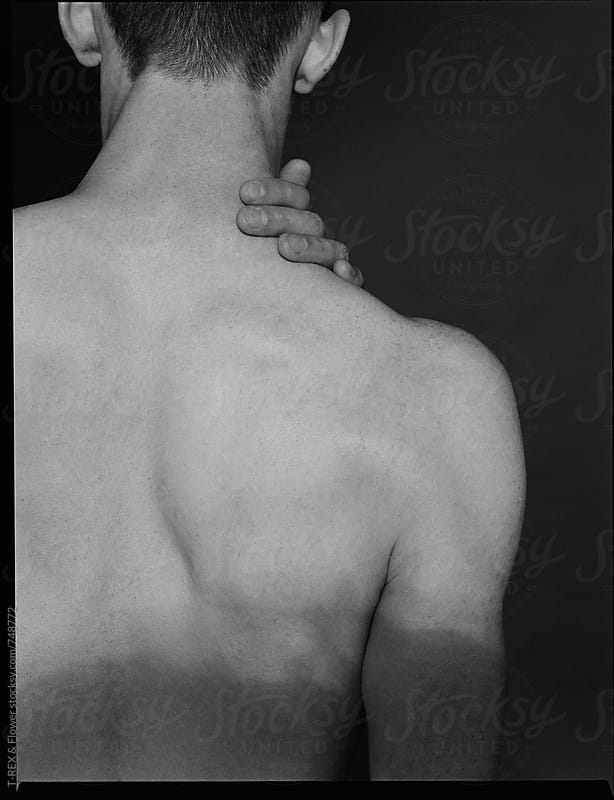 Topless man's back by Danil Nevsky for Stocksy United