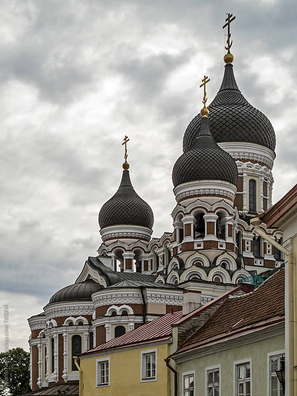 Onion domes of the Nevsky Cathedral behind houses by Melanie Kintz for Stocksy United