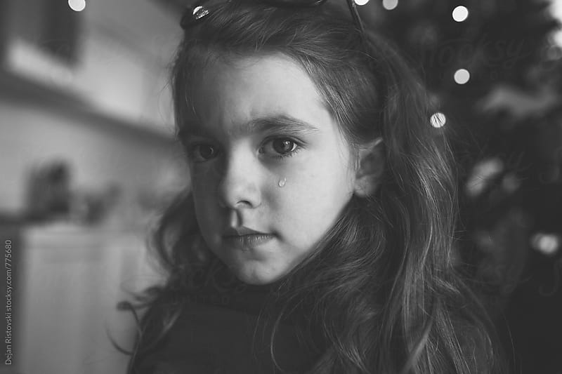 Sad child face. by Dejan Ristovski for Stocksy United