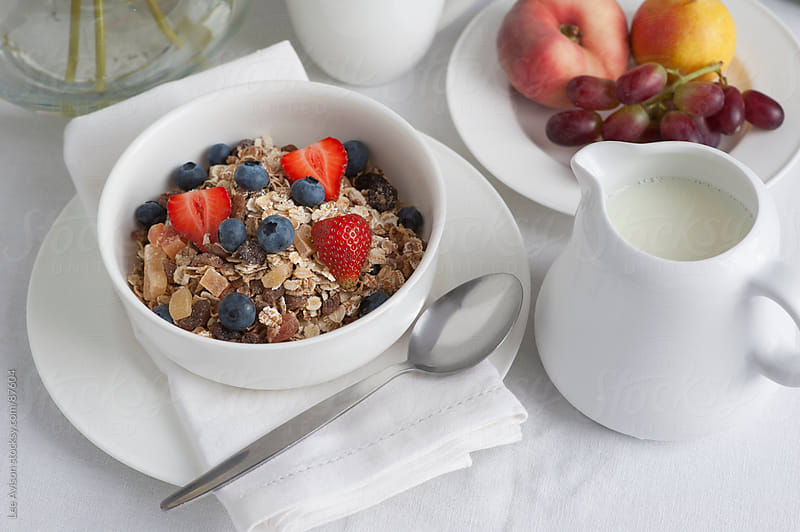 healthy breakfast of muesli and fresh fruit by Lee Avison for Stocksy United