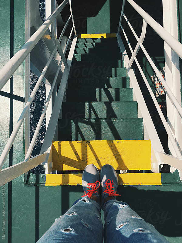 Cute green stairs on a ferry boat by Maja Topcagic for Stocksy United