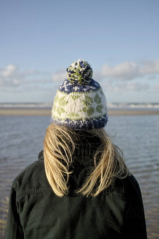Girl with knitted hat by Marcel for Stocksy United
