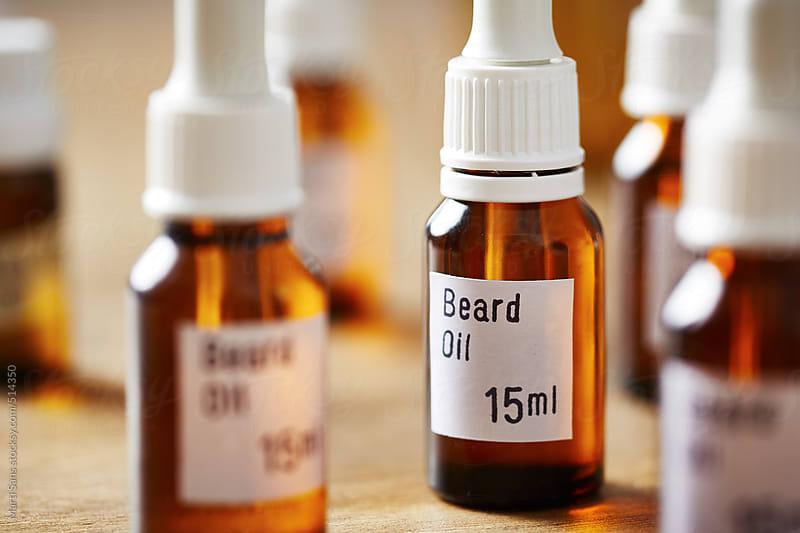 Preparing men's beard oil by Martí Sans for Stocksy United