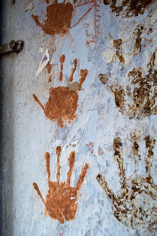 Thumb impressions on a village wall in India by Gabriel Diaz for Stocksy United