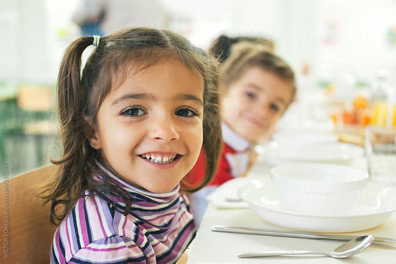 Beautiful Little Girl at the School Canteen by VICTOR TORRES for Stocksy United
