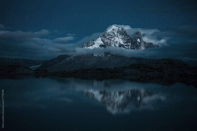 HIgh mountain peaks reflected in the lake at dawn by RG&B Images for Stocksy United