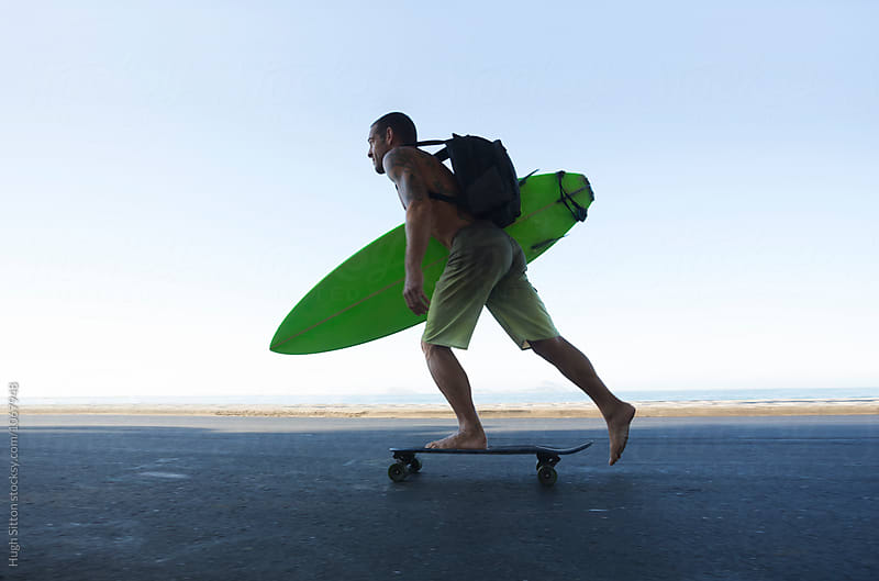 Surfer on skateboard by Hugh Sitton for Stocksy United