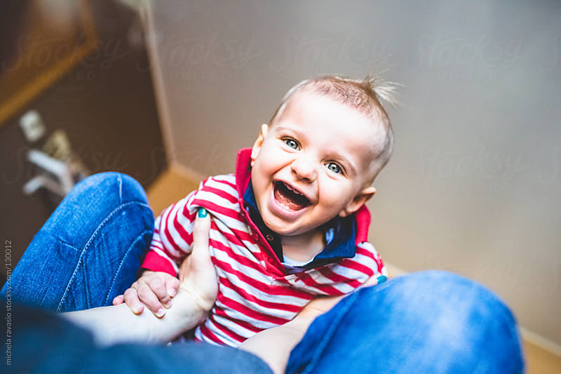 A cute baby having fun by michela ravasio for Stocksy United