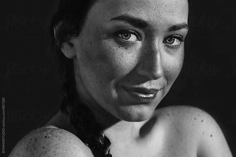 Closeup portrait of a young freckled woman. by BONNINSTUDIO for Stocksy United