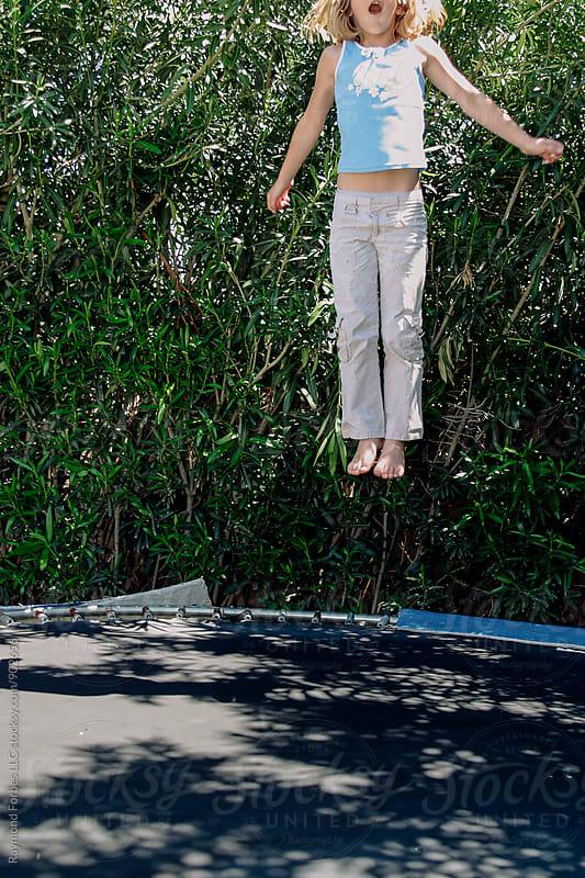 Backyard Fun on Trampoline by Raymond Forbes LLC for Stocksy United