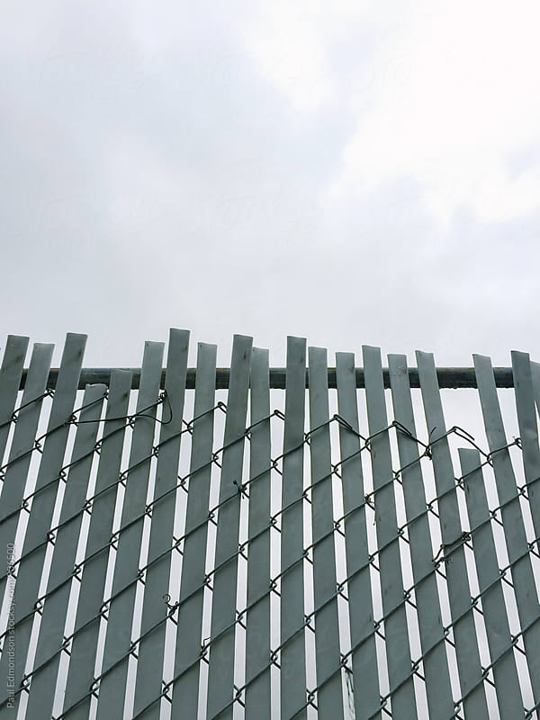 Low angle view of chain-link fence  by Paul Edmondson for Stocksy United