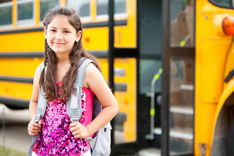 School Bus: Cheerful Young Girl Before School by Sean Locke for Stocksy United