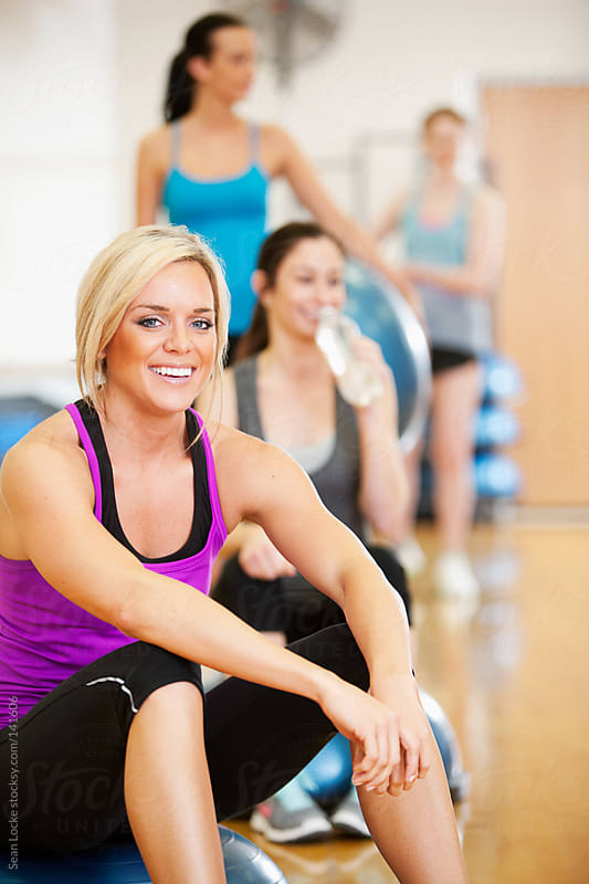 Gym: Fit Woman Waiting for Class to Start by Sean Locke for Stocksy United