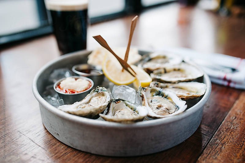 Oysters on the halfshell over ice by Cameron Whitman for Stocksy United