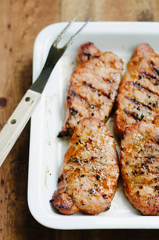 Grilled Boneless Pork Chops by Julie Rideout for Stocksy United