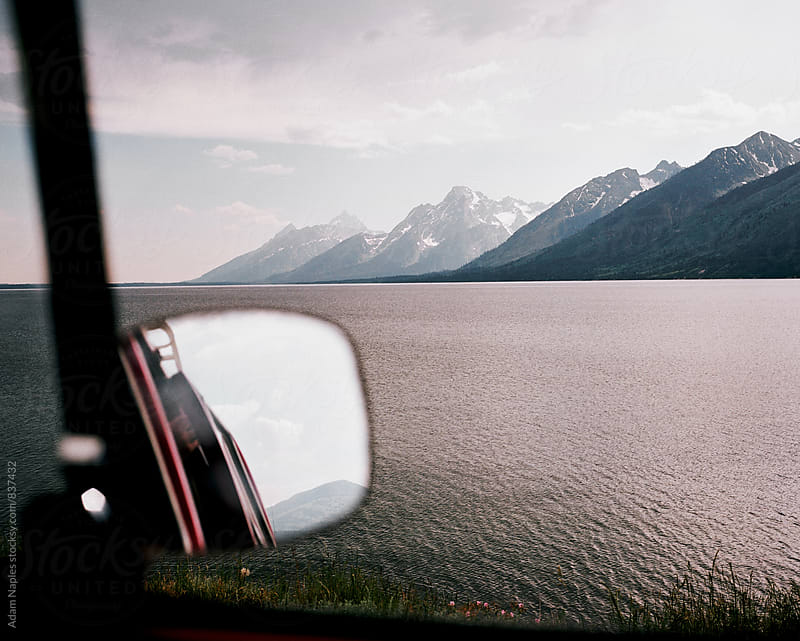 Sideview mirror, Grand Tetons National Park, Wyoming by Adam Naples for Stocksy United