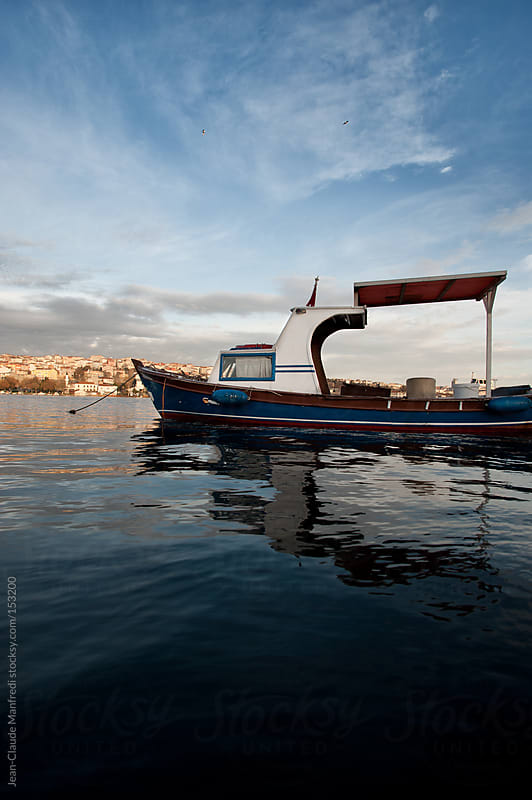 Fishing boat docked at the port in Istanbul by Jean-Claude Manfredi for Stocksy United