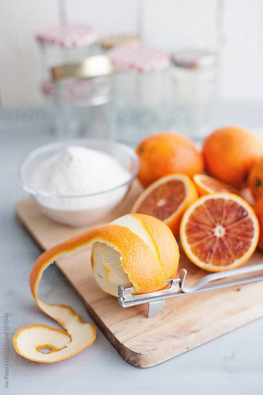 Food: Making of Bitter Orange Marmalade, peeling Oranges by Ina Peters for Stocksy United
