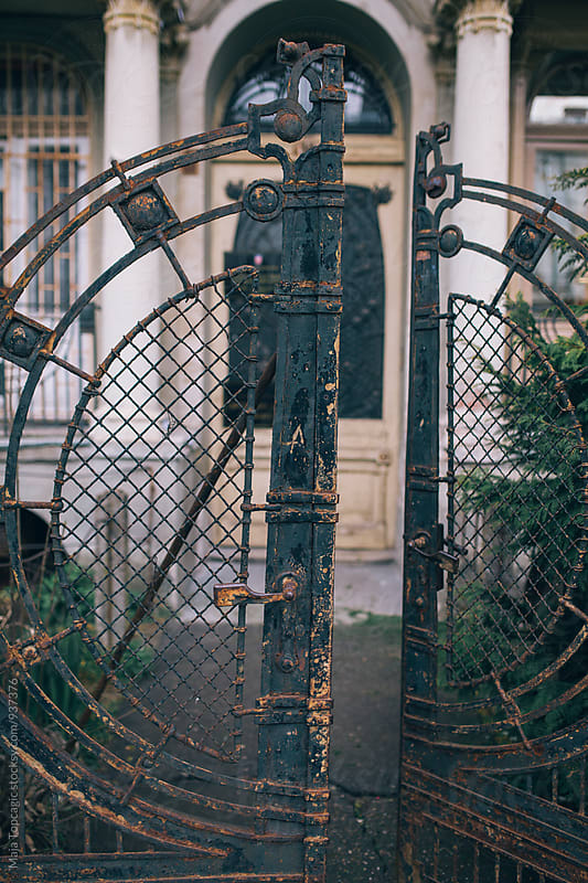 Old vintage rusty doors outside an abandoned house  by Maja Topcagic for Stocksy United