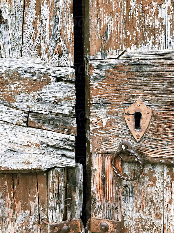 very old wooden door by Juri Pozzi for Stocksy United