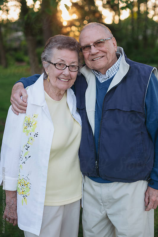 Fun portrait of happy caucasian senior couple outside in nature by Rob and Julia Campbell for Stocksy United
