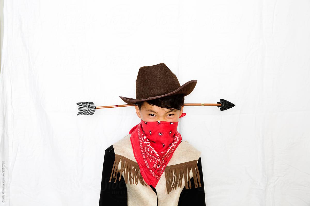 a7ff1c7fdbd87 Boy Wearing Cowboy Costume With Arrow Through His Head