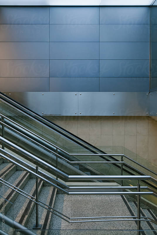 Escalators at the Airport by VICTOR TORRES for Stocksy United