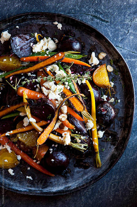 Roasted beetroot, carrot, bean salad with hazelnuts, feta, thyme by Nadine Greeff for Stocksy United