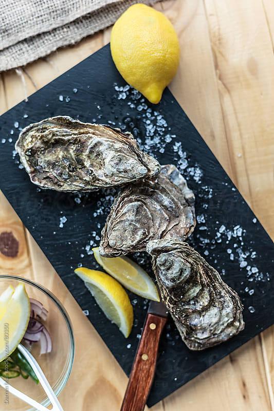 Seasonal Oysters. by Darren Muir for Stocksy United