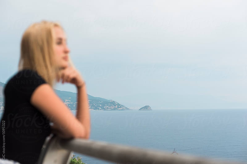 Young woman watching sea panorama by GIC for Stocksy United